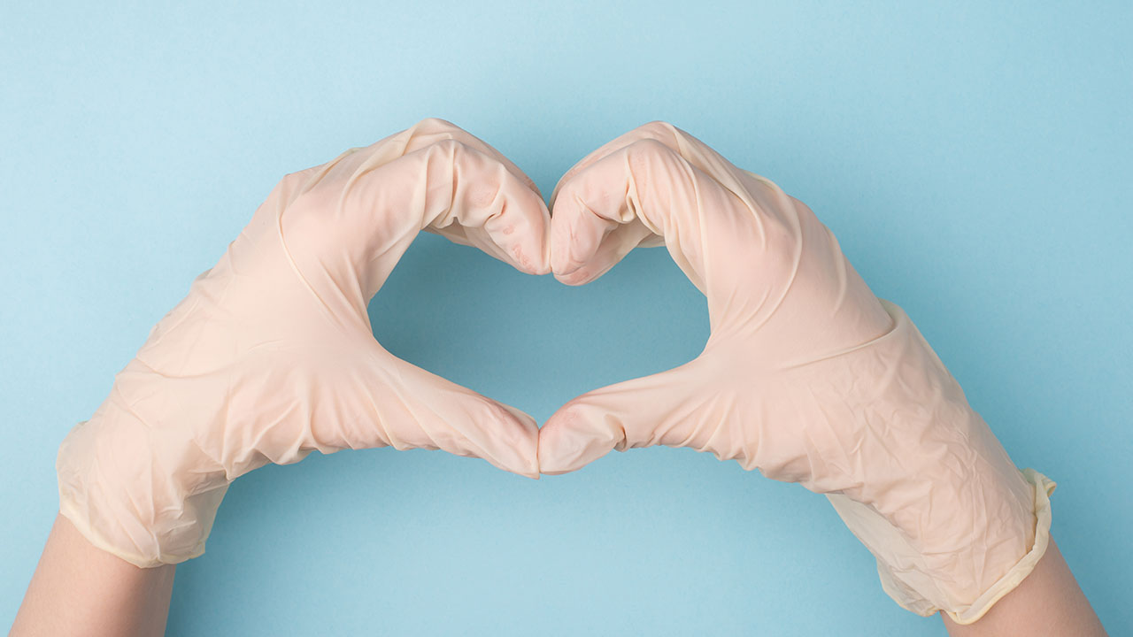 gloved hands in the shape of a heart