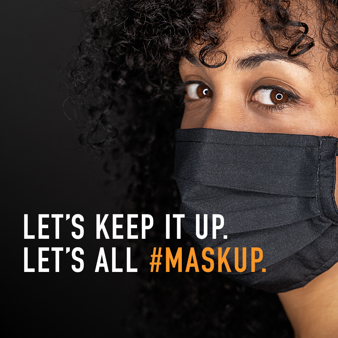 "Woman wearing a mask. Copy says ""Let's keep it up. Let's all #maskup."""