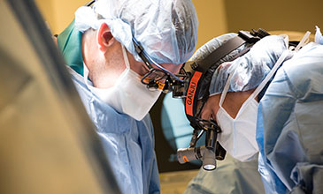 Northwestern Medicine spine surgeon Dr. Aruna Ganju performing surgery.